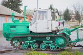 Tractor, Standing In A Row. Agricultural Machinery. Parking Of Agricultural Machinery. poster