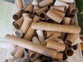 Plastic Container With Many Cardboard Paper Towel And Toilet Paper Tubes poster