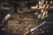 Pirate Treasure Map, Gold Nuggets, Dagger And Pirate Hat On Aged Wooden Table Background. Sea Travel poster