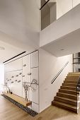Luminous Modern Interior With White Walls And A Stair With Wooden Rungs And A Glass Railing. There I poster