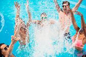 Cropped Close Up Shot Of Youth Going Crazy In The Pool, Splitting Water And Go Insane, Huge Splashes poster