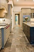foto of armoire  - beautiful expensive custom kitchen with slate floor and granite counters - JPG