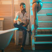 Bearded Man Drink Tea Or Coffee At Naked Woman. Couple In Love In Morning. Sex Games Desire And Orga poster