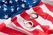 Flag Of America And Handcuffs. Usa Flag And Pair Of Metallic Handcuffs. Keep Within The Laws Of The  poster