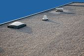 Inverted roof with chimney and skylight and gravel top