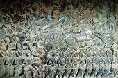 stock photo of asura  - Sculpted wall at corridor of Angkor Wat Cambodia - JPG