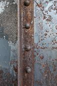 Rusted Rivets In Angle Iron Background Image poster