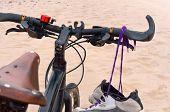 Sneakers Hanging On The Bike, Bike On The Beach, Sea And Bike poster