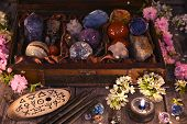 Box With Magic Crystals And Stones, Black Candle And Spring Flowers. Occult, Esoteric And Divination poster