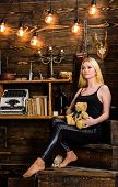 Girl In Black Clothes Holds Teddy Bear Toy In Hand, Wooden Interior On Background. Woman On Dreamy F poster