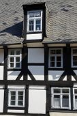 Facade of half-timbered building in the historical center of Goslar, Germany.                        poster
