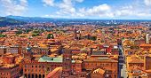 Bologna Italy. Panoramic aerial view of old town with terracotta houses and tegular roofs with centr poster