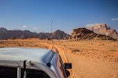 Car Sightseeing Tour In Wilderness Desert Dunes And Dry Rocks Environment Space poster