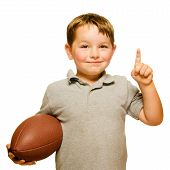 Child with football celebrating by showing that he's Number 1 isolated on white