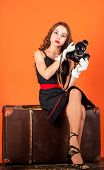 Beautiful Child Photographer Hold Retro Camera. Travel Journalist Sit On Luggage. Little Reporter Ma poster