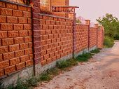 Beautiful Stone Fence Made Of Blocks. Fence Of Foam Concrete Blocks To Fence The Territory.  Brickwo poster