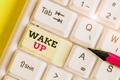 Handwriting Text Wake Up. Concept Meaning An Instance Of A Demonstrating Waking Up Or Being Woken Up poster
