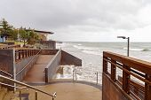 Capricorn Coast Australia - A Walkway And Viewing Deck On The Coast At High Tide On A Cloudy Day poster