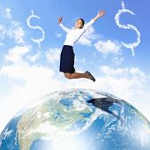 Business woman jumping up above the planet Earth