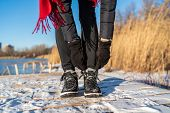 Ready for winter woman tying boot laces hiking boots for snow and ice anti slippery soles for outdoo poster