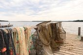 Fishing nets at lake Urbino at French island Corsica poster