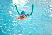 Cute Little Asian Toddler Boy Child Kicking Feet In Swimming Costume Wear Swimming Goggles Use Pool  poster