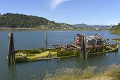 pic of bayou  - A wreck and abandoned fishing vessel in a bayou in Gold Beach OR - JPG