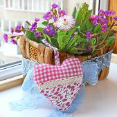 foto of pot-bellied  - Decoration floral composition in a small basket f hyacinths bellis and primrose Spring flowers on a balcony - JPG