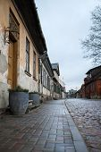 Old Countryside City Street With Historic Architecture. Cloudy, Overcast Day. Located In Latvia. poster