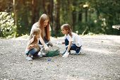 Children Collects Garbage In Garbage Bags In Park poster