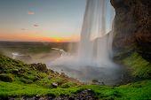 Beautiful Seljalandsfoss waterfall in Iceland during Sunset, Europe poster