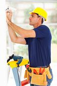 stock photo of cctv  - professional cctv technician adjusting surveillance camera angle - JPG