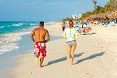 VARADERO,CUBA-APRIL 7:Tourists running at the beach April 7,2013 in Varadero.With over a million vis