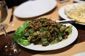 foto of tabouleh  - Tabouleh salad on a white plate in an armenian restaurant - JPG