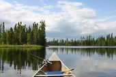 Canoe With Fishing Gear Heading Out On Northern Lake