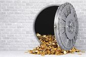 stock photo of vault  - open a bank vault with a bunch of gold coins - JPG