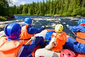 pic of rafters  - Rafters in a rafting boat on Pistojoki river in Karelia - JPG
