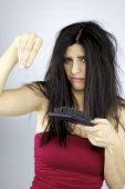 image of alopecia  - Unhappy woman holding lost hair in hand
