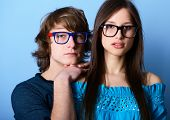 stock photo of indigo  - Fashionable young couple wearing trendy glasses - JPG