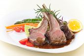 stock photo of lamb  - Rosemary roasted lamb chops  - JPG