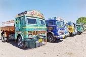 Row Of Colorful Indian Trucks Parked At A Dhabha In Gujarat