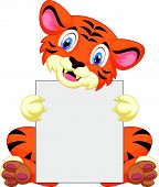 stock photo of white tiger cub  - Vector illustration of Cute tiger cartoon holding blank sign - JPG