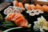 foto of plate fish food  - Sushi rolls with vassabi on the plate - JPG