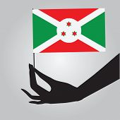 stock photo of burundi  - Burundi flag in his hand - JPG