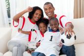 Afro-american Family Celebrating A Football Goal