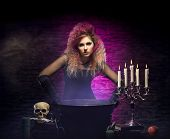 image of dungeon  - Young and beautiful witch in a dungeon - JPG