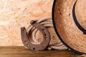 foto of lasso  - American West still life with old horseshoe - JPG
