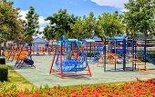 foto of swingset  - Public playground in the park for children  - JPG