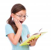 image of skinny girl  - Cute girl is reading book  - JPG