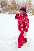 foto of snowball-fight  - Funny child playing with snowballs in winter - JPG
